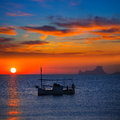 Ibiza sunset es vedra view and fisherboat formentera menorquina from orange sky Royalty Free Stock Image