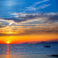 Ibiza sunset es vedra view and fisherboat formentera menorquina from orange sky Royalty Free Stock Photos