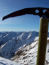 Ice ax with mountains Royalty Free Stock Image