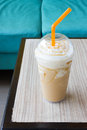 Ice blend caramel coffee on wooden table Stock Image