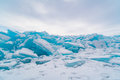 Ice blocks covered with snow in Lake Baikal Royalty Free Stock Photo