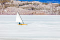 Ice-boat sailing frozen Lake Laberge Yukon Canada Royalty Free Stock Photo