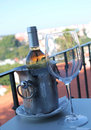 Ice bucket with bottle of wine and a glass on the table Royalty Free Stock Photo
