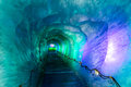 Ice cave in mer de glacer glacier chamonix france colorful icy corridor digged inside glace mont blanc massif Stock Photo