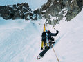 Ice climbing mountaineer on a mixed route of snow and rock duri during the winter western alps italy europe Royalty Free Stock Photography