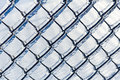 Ice coated chain link fence from an ice storm covered a severe icestorm Royalty Free Stock Photography