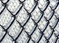 Ice coated chain link fence from an ice storm covered a severe icestorm Royalty Free Stock Photo