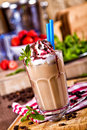 Ice coffee with mint and strawberry syrup Stock Images