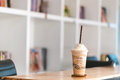 Ice coffee on wooden in cafe Royalty Free Stock Photo