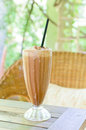 Ice coffee on the wooden table and blurry background Stock Photo