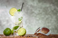 Ice cold lemon summer party drink with and a slice of on a hot day Stock Images