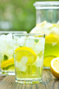 Ice cold lemonade on the table Royalty Free Stock Images