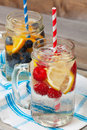 Ice cold sparkling water over ripe fresh fruit make healthy thirst quenching beverage hot summer day Stock Photography