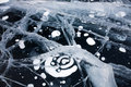 Ice cracks and air bubbles on baikal surface Royalty Free Stock Image