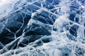 Ice cracks on thick frozen water surface Royalty Free Stock Photos