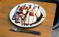 Ice cream, banana, strawberry, blueberry, chocolate waffles Royalty Free Stock Photo