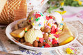 Ice cream bowl with sprinkles banana, almonds, love, heart, happiness, many, waffle Royalty Free Stock Photo