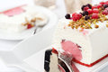 Ice cream cake with berries and nuts Stock Image