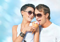 Ice cream close up portrait of joyful young couple eating Royalty Free Stock Photos