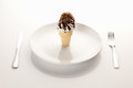 Ice cream cone on a place setting Royalty Free Stock Photos