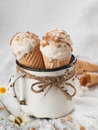 Ice cream cones in an old vintage mug selective focus Royalty Free Stock Photography