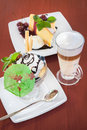 Ice cream cup, cake and coffee latte at table Royalty Free Stock Photo