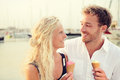 Ice cream happy couple eating ice cream cone outdoors enjoying nature fresh young romantic enjoying summer in love young Royalty Free Stock Images