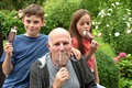 Ice cream lolly siblings and her grandfather with Stock Image
