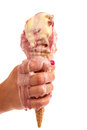 Ice cream melting in hand Royalty Free Stock Photo