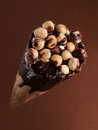Ice cream with nuts and chocolate selective focus Stock Photography