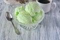 Ice-cream pistachio on a wooden white table Royalty Free Stock Photo