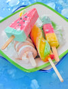 Ice cream pops various on plate Royalty Free Stock Images