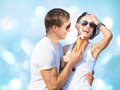 Ice cream portrait of happy young couple with Stock Image