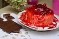Ice-cream poured with cherry jam. Royalty Free Stock Photo