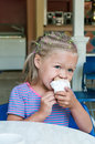 Ice cream pretty little girl eating Stock Photography