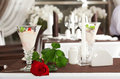 Ice cream and red rose on decorated table Royalty Free Stock Photography