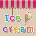 Ice cream shopfront sign colorful paper signs on brown background and awning Royalty Free Stock Photography