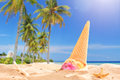 Ice cream splashed in the sand on a beach sunny day with focus Royalty Free Stock Images