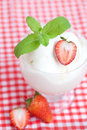 Ice cream strawberry with mint in a glass bowl on plaid fabric Stock Photo