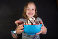 Ice cream sundae a child holding an with chocolate syrup Royalty Free Stock Images