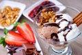 Ice cream sundae, chocolate, jam and sliced strawberry