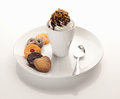 Ice cream sundae on a plate with cookies Stock Images