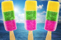 Ice cream in three colors on summer sea background Royalty Free Stock Images