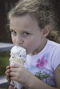 Ice cream time don t mess with my ice cream a freckle faced little girl eats a dripping cone covered sprinkles she looks up as if Royalty Free Stock Images