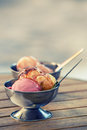 Ice cream in two retro metal bowls on a wooden table backgrounds created for your text summer time Stock Photo