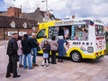 Ice cream van queue a of customers waiting in line at an in a town centre stratford on avon warwickshire england uk Royalty Free Stock Photos