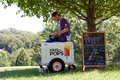 Ice Cream Vendor Waits For Customers In Park Royalty Free Stock Photography