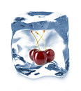 Ice cube isolated and cherry close up Stock Images