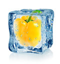 Ice cube and pepper Royalty Free Stock Photos