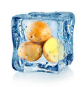 Ice cube and potato Stock Photo